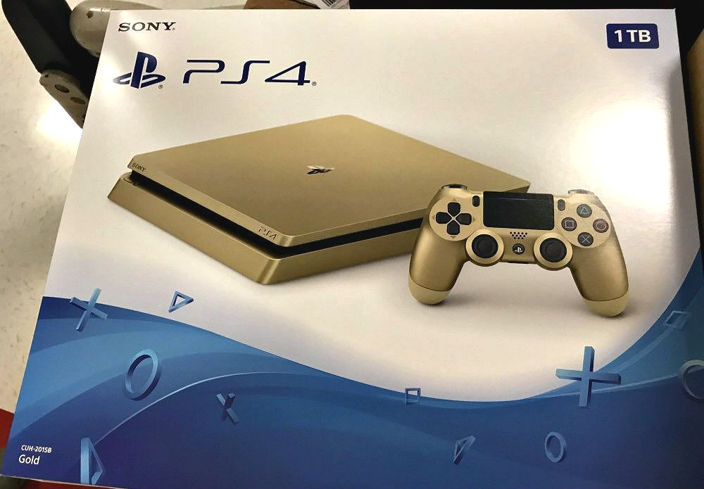 Gold PS4 Slim 1TB Box Image & Rumors of June Release Spotted.jpg